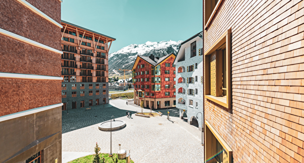 Die Planer des Resorts Andermatt Reuss bedienten sich traditionellen Baumaterialen. (Foto Andermatt Swiss Alps AG).