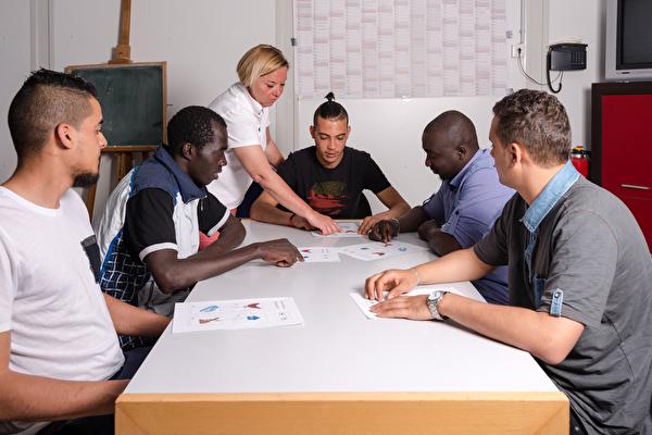 Migranten lernen Deutsch