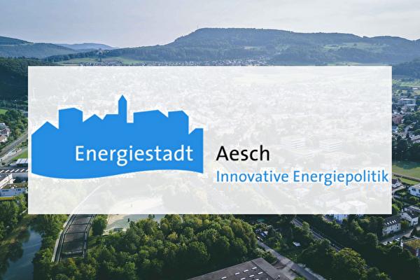 Logo Energiestadt Aesch vor einem Luftbild