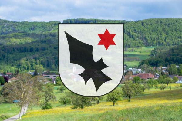 Aescher Wappen mit dem Dorf im Hintergrund